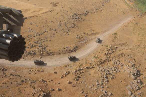 Бронетехника и вертолёты армии России выдвинулись в район объектов армии США в Сирии