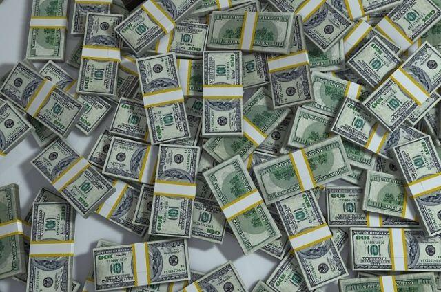 Курс доллара на Мосбирже снижается до 68,29 рубля